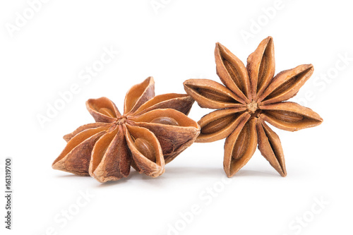 Star anise spice fruits and seeds isolated on white background closeup Wallpaper Mural