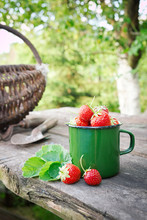 Green Enameled Mug Of Strawber...