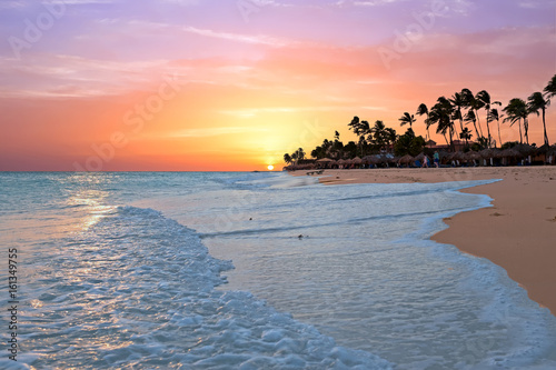 Photo Stands Caribbean Druif beach at sunset on Aruba island in the Caribbean sea
