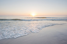 Beautiful Sunset And Gentle Wave At The Shallow Beach