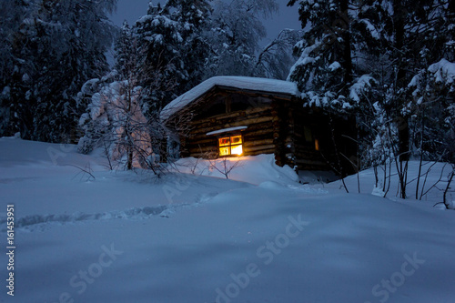 A secluded hut deep in the winter forest Canvas Print