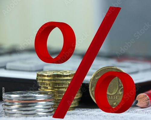 знак проценты на фоне монет Fotobehang