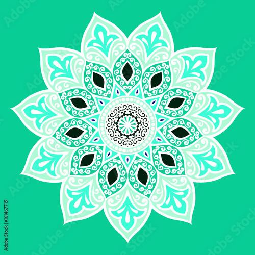 kwiat-mandali-w-bialych-i-turkusowych-barwach-na-turkusowym-tle