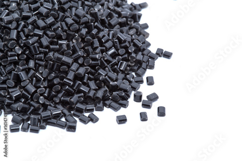 Fotomural Black plastic polymer granules on white background
