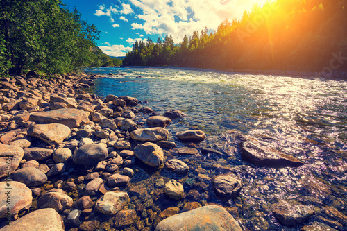 Mountain valley with the river in evening. Beautiful nature Norway