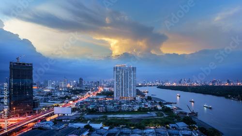 Cityscape of Bangkok in twilight viewing Rama III road along Chao Phraya river , Wallpaper Mural