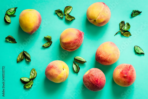 Ripe Fresh Organic Peaches on Turquoise Background, Summer Food Wallpaper, Horizontal Top View