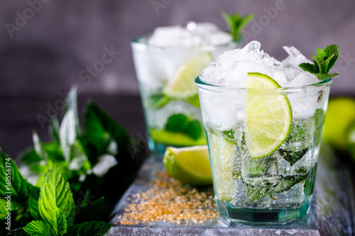 Mojito Cocktail.Mint, lime, ice ingredients for making  and bar utensils.Cold Drink.Top View.Copy space for Text.selective focus.
