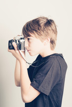 Little Boy With Vintage Reflex Camera -  Filtered Retro Style
