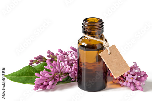 Fototapeta Relaxing essential oil, fresh flowers, relaxation. Isolated on a white background. obraz