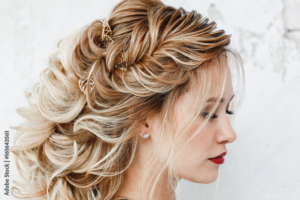 Fototapeta Beautiful woman with dyed hair with Evening hairstyle Greek braid