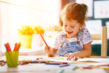 Child  Girl Draws With Colored...