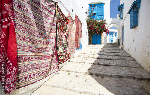 Poster Tunesië sales of carpet on the street in Tunisia city