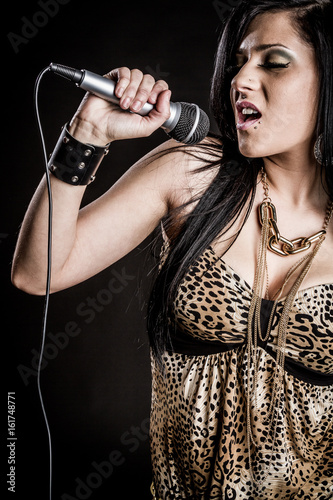Photo  Woman Singing with Microphone