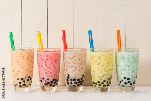 Boba / Bubble tea. Homemade Various Milk Tea with Pearls on wooden table.