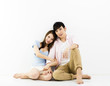 Portrait Of Happy Young Couple Sitting On Floor.