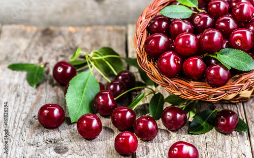Organic cherries, farm fresh fruits on farmer table