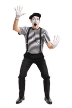 Mime Holding His Hands On An Invisible Wall