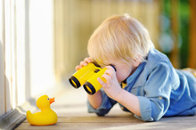Cute Little Boy Playing With R...