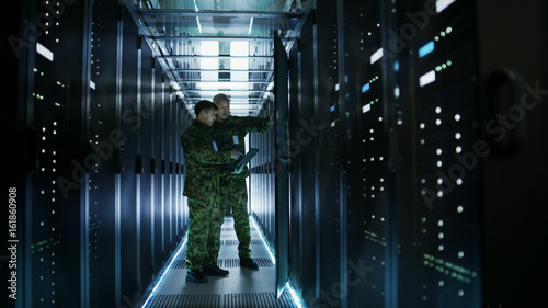 Photo  In Data Center Two Military Men Work with Open Server Rack Cabinet