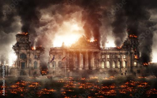 Fotografiet  Destroyed building burning