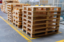 Stacked Wooden Pallets At A Storage