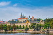 Scenic panorama of the Old Town architecture with Vltava river and St.Vitus Cathedral in Prague, Czech Republic