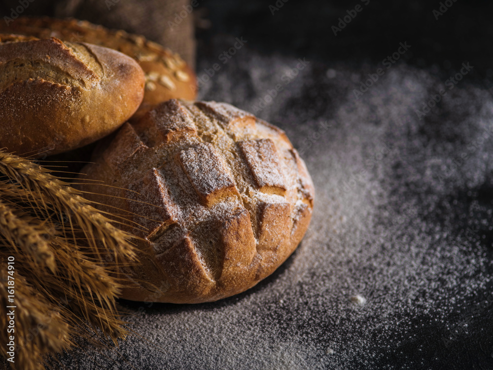 Different kinds of bread on background.