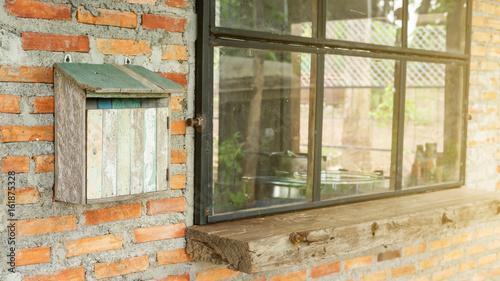 Cadres-photo bureau Ancien hôpital Beelitz wooden mailbox in front of a house near a window.