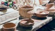 Close up of pottery drying on table