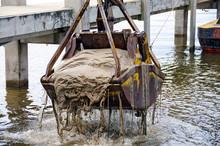 Dredger Bucket Dredging Lake Bottom In Marina