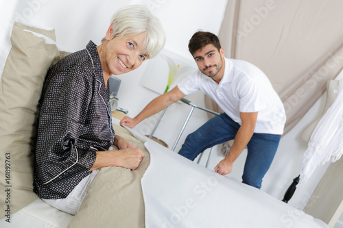 bedridden employer posing and smiling Canvas Print
