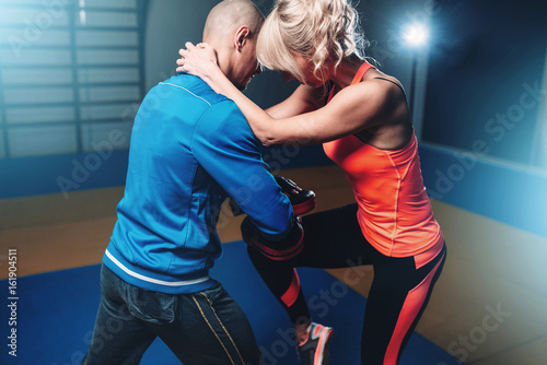 Photo Stands Martial arts Womens self defense workout with instructor