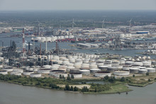 Aerial View On The East Side Of Port Of Antwerp With Total Antwerp Oil Tanks In The Foreground