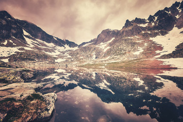 FototapetaColor toned picture of a lake in High Tatra Mountains, Slovakia.