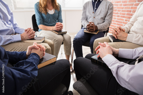 Group Of People Praying Together