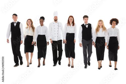 Fotografía  Restaurant Staff Walking Against White Background