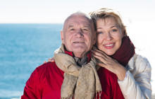 Mature Couple Walking By Sea