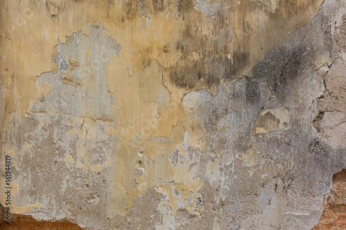 Foto auf AluDibond Alte schmutzig texturierte wand Verwitterte Wand mit gelbem Anstrich
