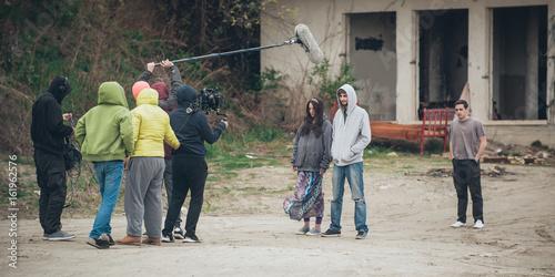 Photo  Behind the scene. Film crew filming movie scene outdoor