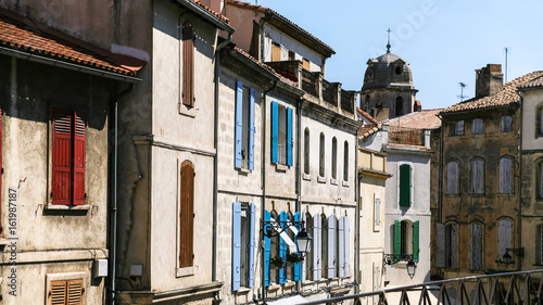 facades of old apartment houses in Arles city Canvas Print