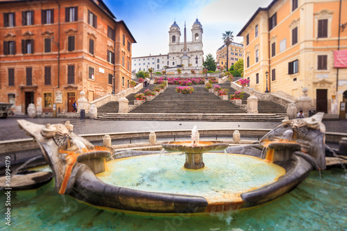 Photo Stands Rome Spanish steps blurred in vintage style, Rome, Italy,Europe. Rome Spanish Steps (Scalinata della Trinità dei Monti) are a famous landmark and attraction of Rome and Italy.