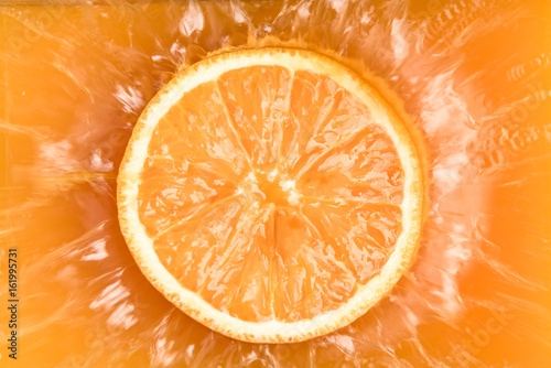 Photo stop-motion,splash orange juice, drop orange into orange juice.
