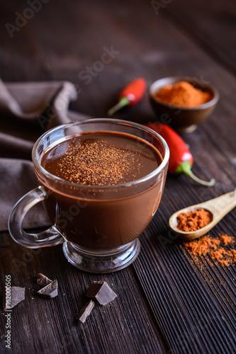 Foto op Plexiglas Chocolade Hot chocolate with red chili pepper