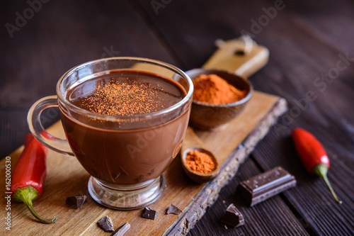 Staande foto Chocolade Hot chocolate with red chili pepper