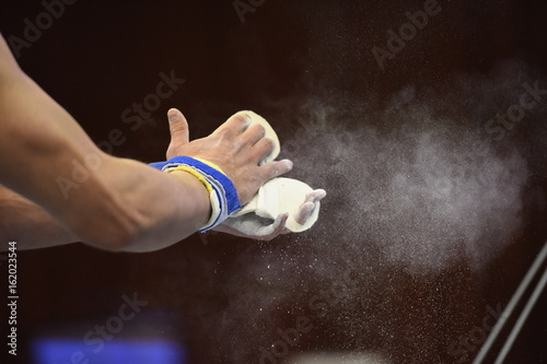Foto op Canvas Gymnastiek mens Artistic Gymnastics hands Close up Grips and Chalk