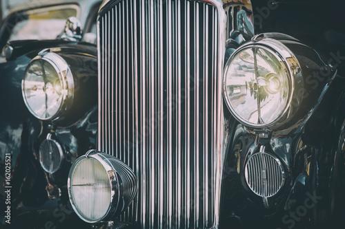 Keuken foto achterwand Vintage cars Front view of black luxurious classic vintage car. Retro toned postcard, poster.