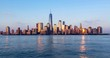 New York City Financial District skyscrapers and Hudson River. Timelapse from sunset to twilight. Lower Manhattan