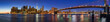 Panoramic view of Lower Manhattan Financial District skyscrapers at twilight with the Brooklyn Bridge and the East River. New York City