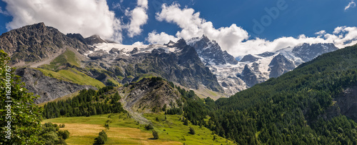 Panoramic Summer view of the mountains and glaciers in Ecrins National Park (La Meije, Glacier du Tabuchet) from the village of La Grave. Hautes-Alpes, PACA Region, Southern French Alps, France